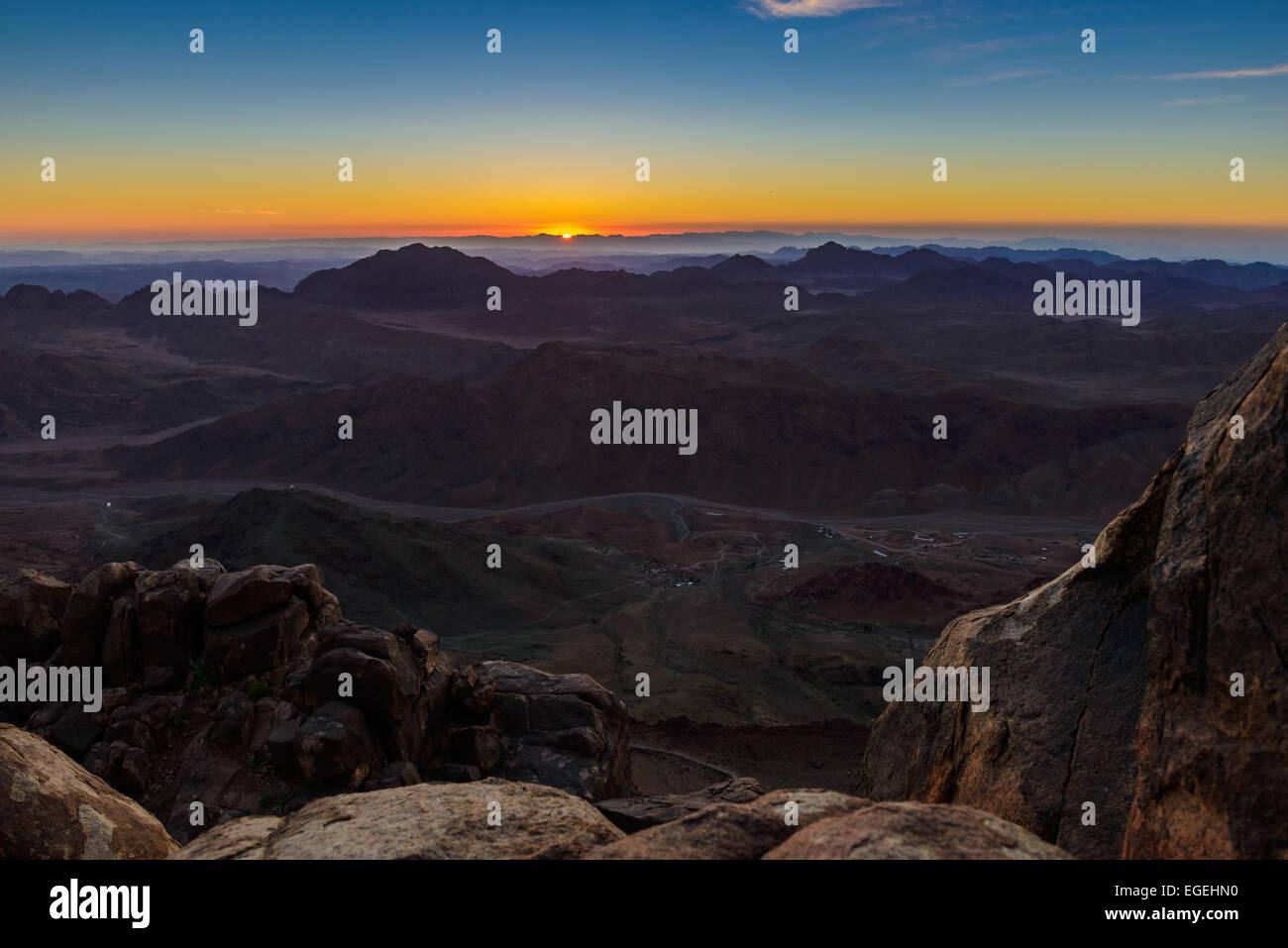 Sunrise at Mount Sinai, Egypt. Bedouins bring tourists in the night to Mount Sinai, Egypt to meet sunrise. - Stock Image