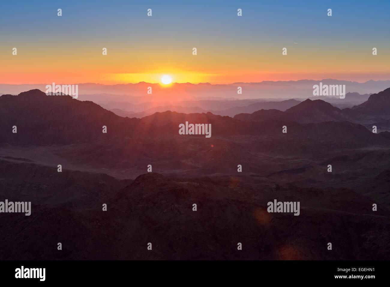 Sunrise at Mount Sinai, Egypt. Bedouins guide tourists in the night to Mount Sinai, Egypt to meet sunrise. - Stock Image