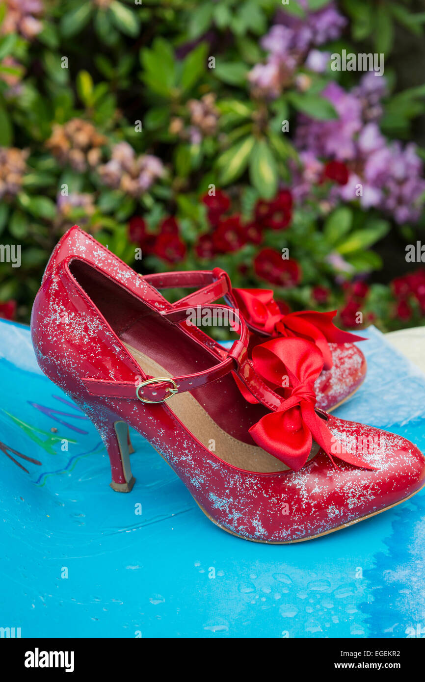 Womens red stiletto shoes with bow and glitter Derbyshire England - Stock Image