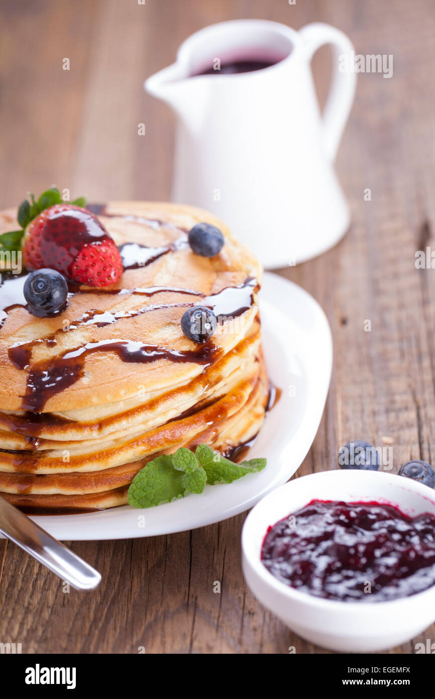Delicious sweet French pancakes on a plate with fresh fruits - Stock Image
