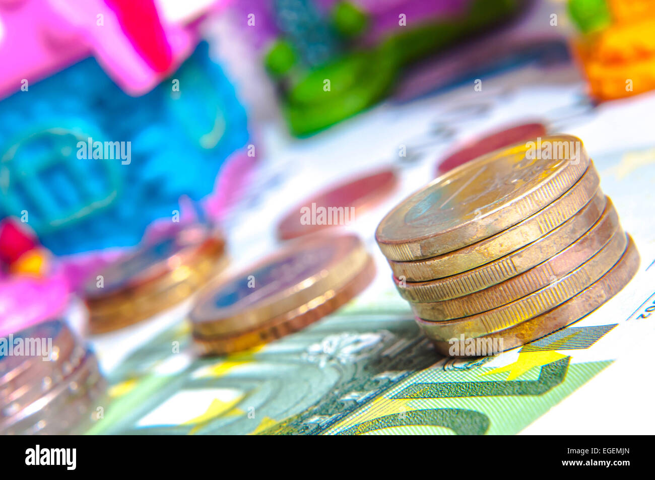 a tower of Euro coins, banknote, European currency - Stock Image