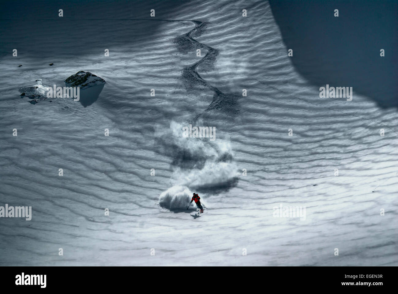 Amazing view of a skier riding down the piste - Stock Image