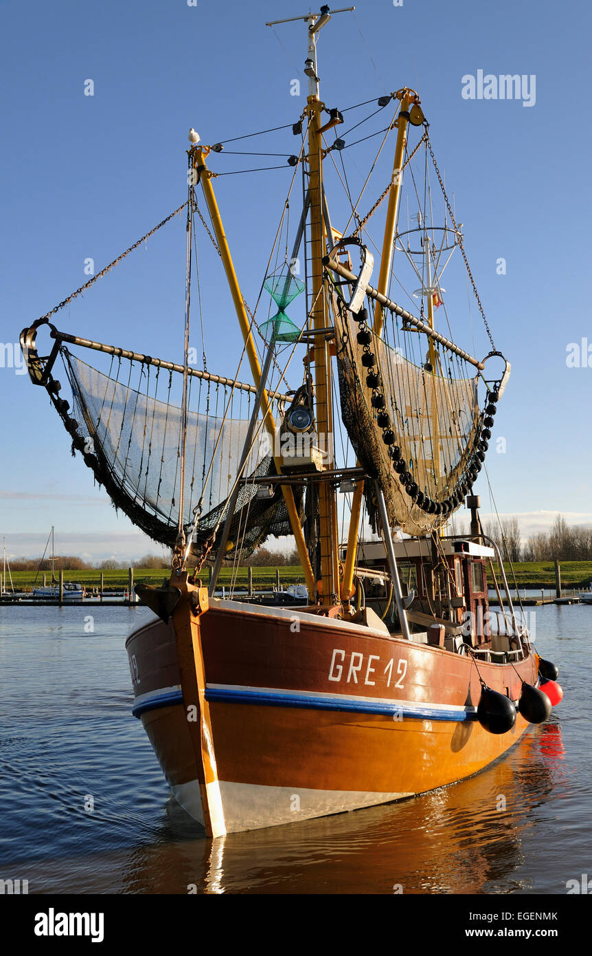 Shrimp boat in the harbour of Greetsiel, North Sea, East Frisia, Lower Saxony, Germany Stock Photo