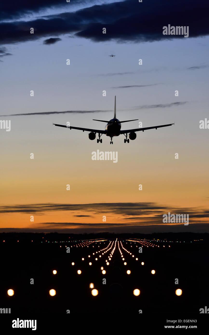 Aircraft landing at sunset, Airbus, runway, landing lights, Munich Airport 'Franz Josef Strauss', Munich, - Stock Image