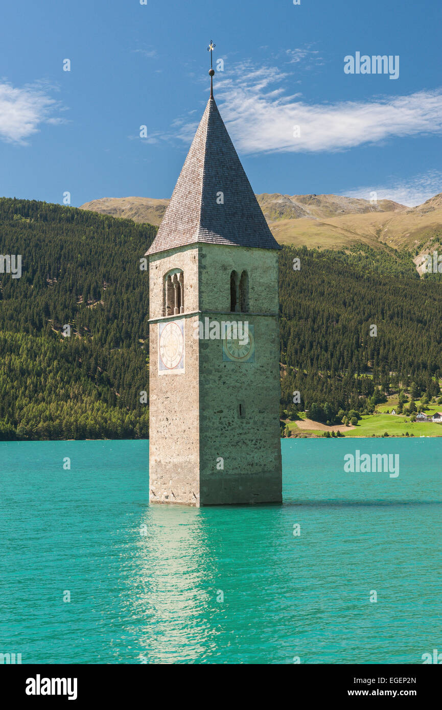 Steeple, bell tower of the submerged church of the village of Alt-Graun in Lake Reschen, or Reschensee Lake, Graun, - Stock Image