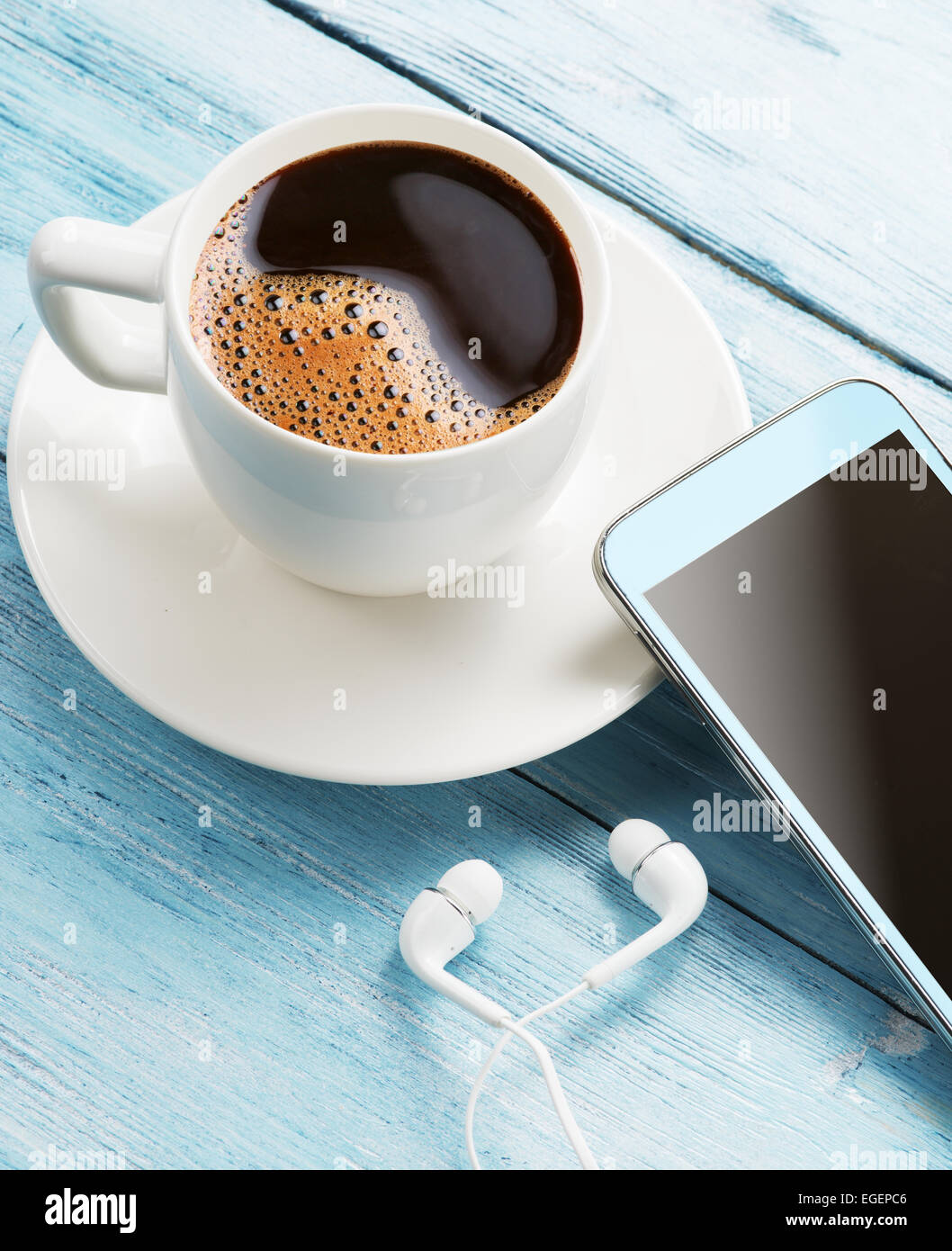 Coffee break. Office table with different gadgets on it. Top view. - Stock Image