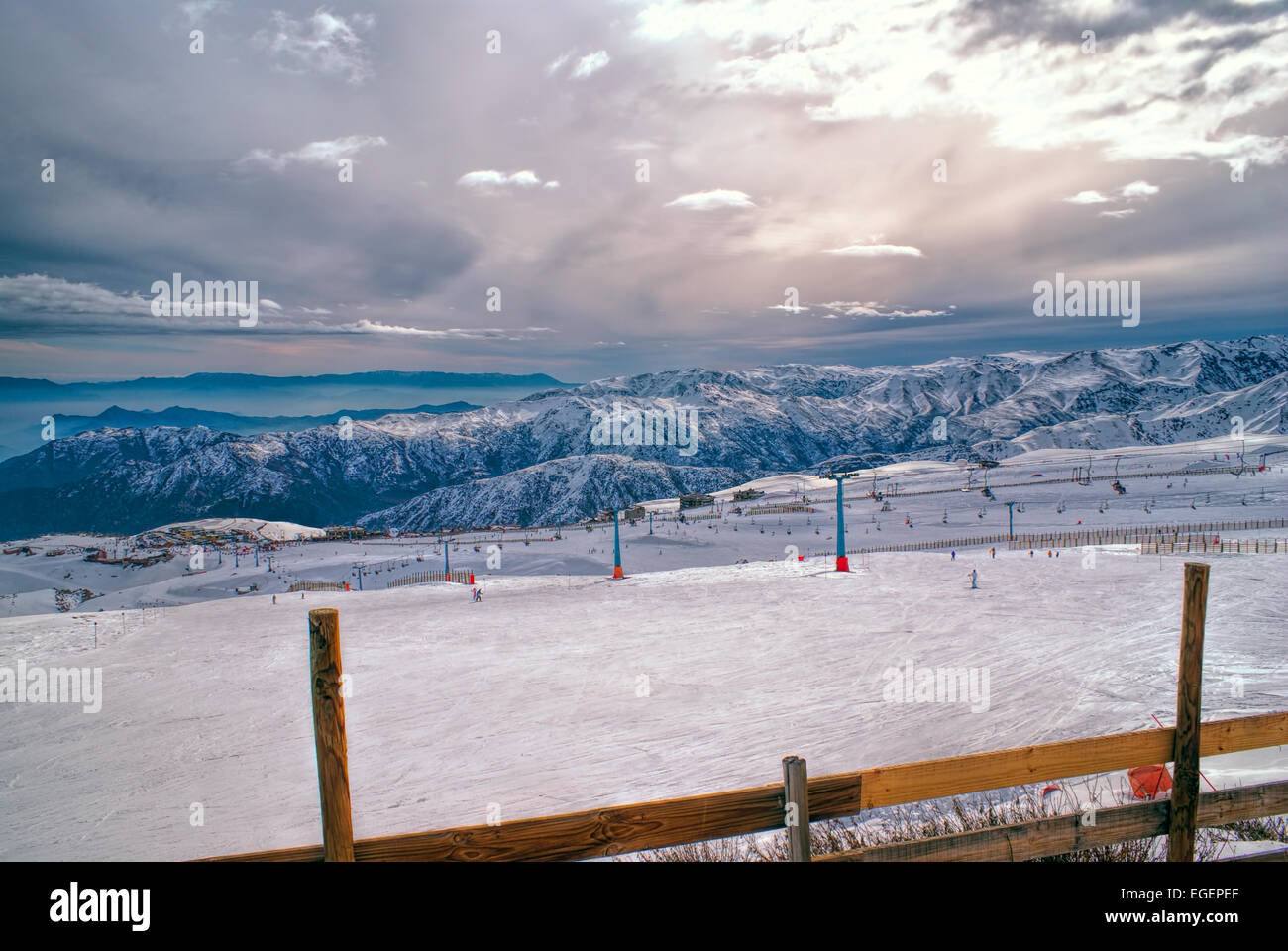 Picturesque view of piste in Valle Nevado under gloomy grey sky - Stock Image