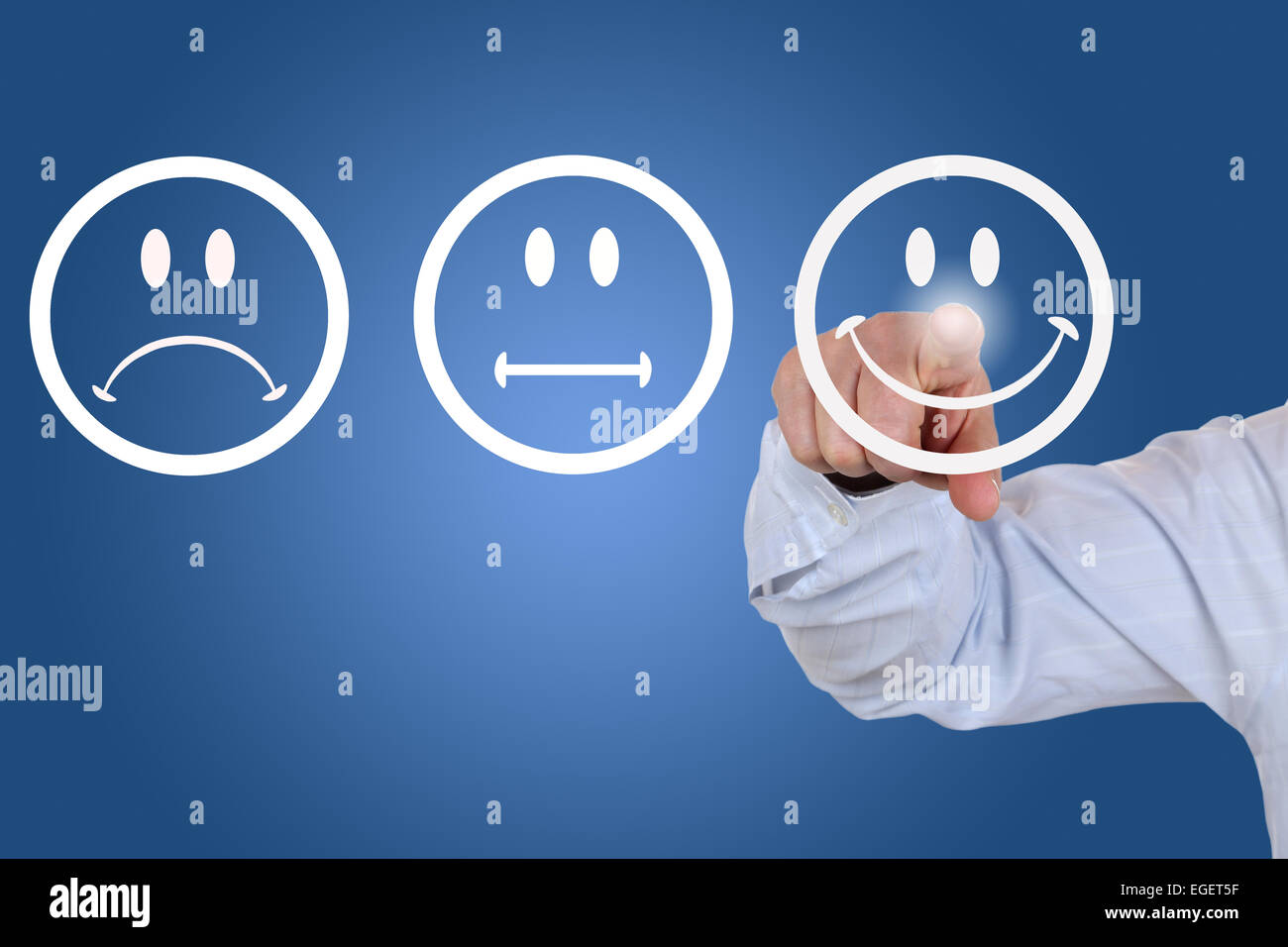 Businessman gives a positive vote for service quality with a smiley - Stock Image