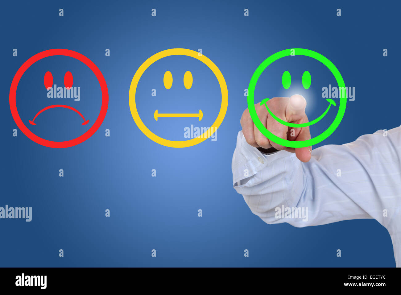 Businessman gives a positive vote for service quality with a green smiley - Stock Image