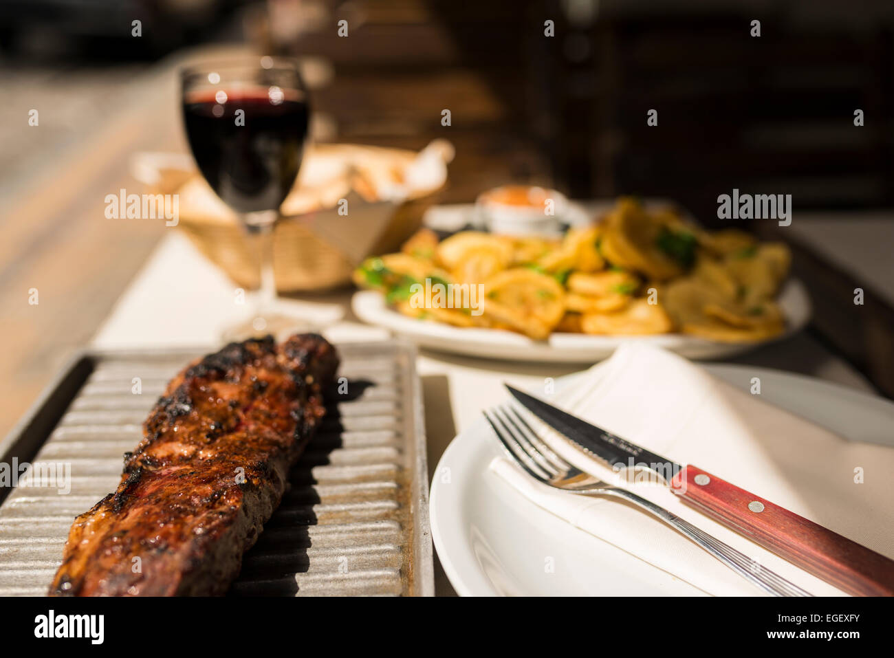 Steak meal at a traditional Parrillia, San Telmo, Buenos Aires, Argentina - Stock Image