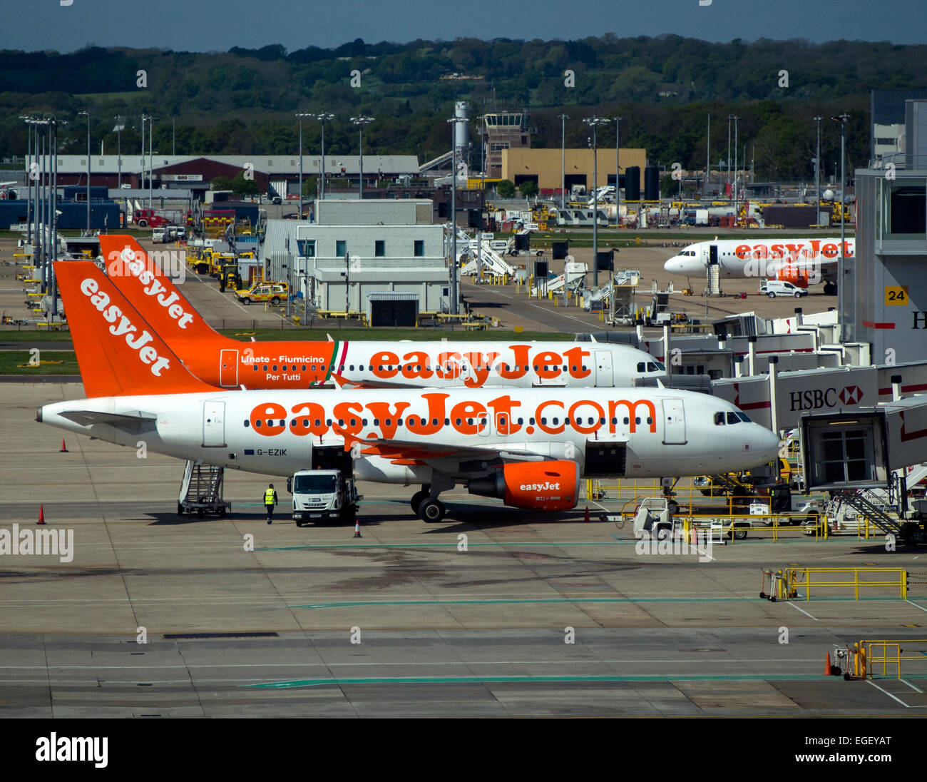 two EasyJet A319 airliners on the runway at Gatwick - Stock Image