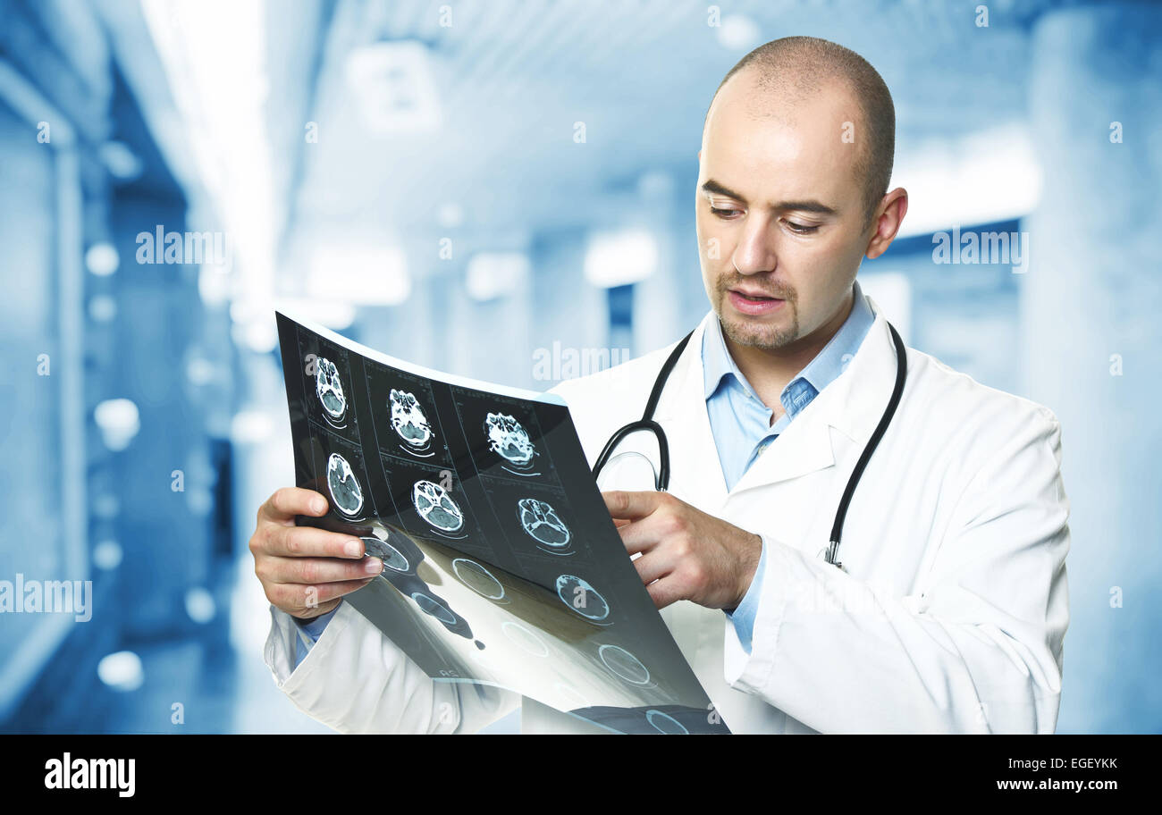 portrait of caucasian doctor check xray - Stock Image