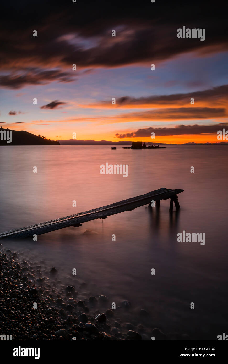 Jetty on Cobacabana Beach at dusk, Copacabana, Lake Titicaca, Bolivia - Stock Image