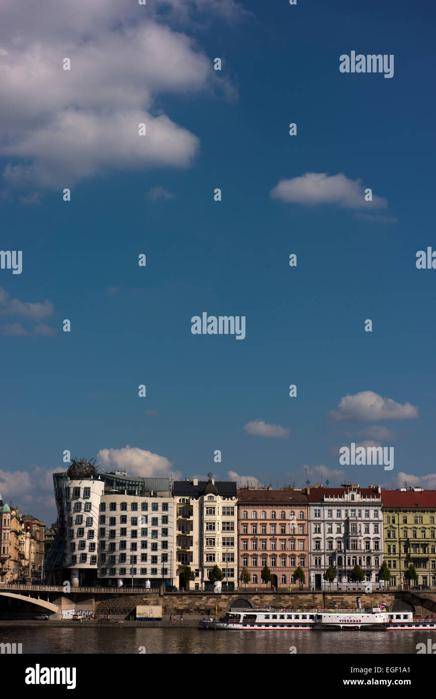 Dancing Building and historic buildings fronting the Vltava River in central Prague. - Stock Image