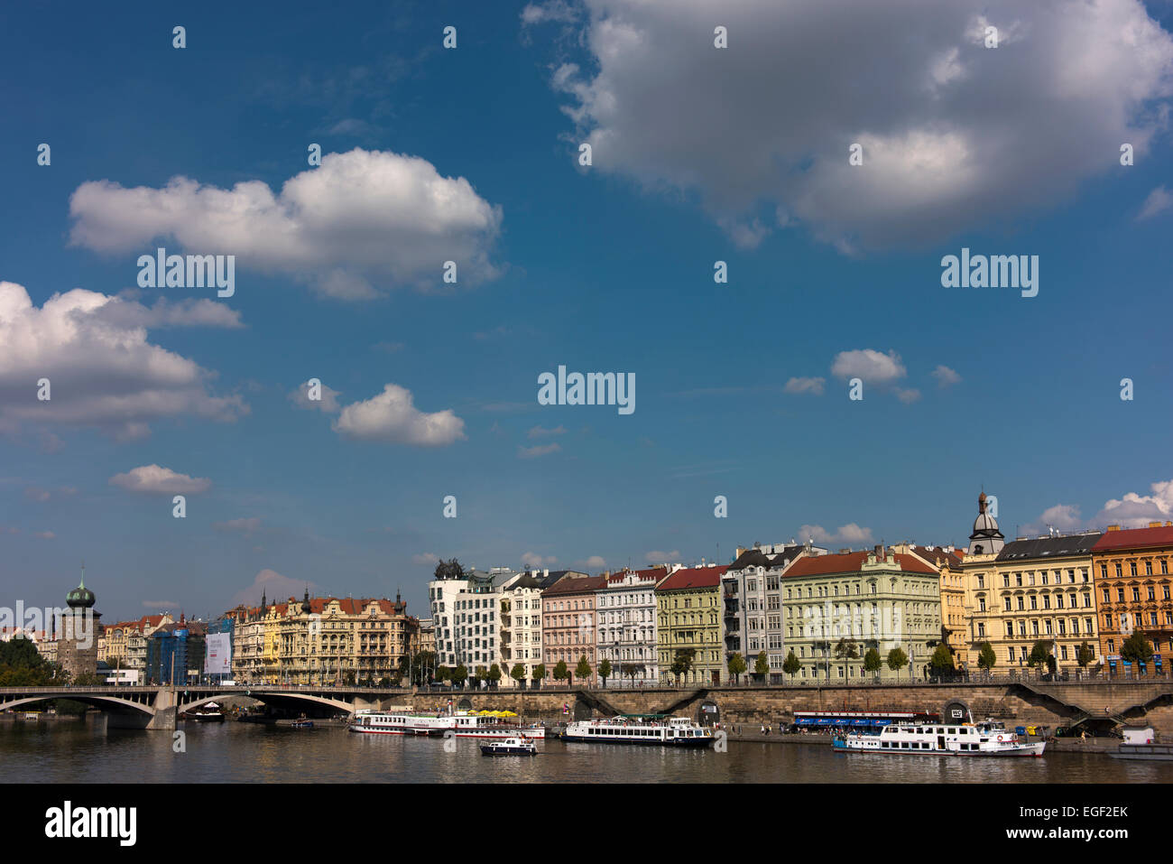 Jiraskuv Bridge and historic buildings fronting the Vltava River. - Stock Image