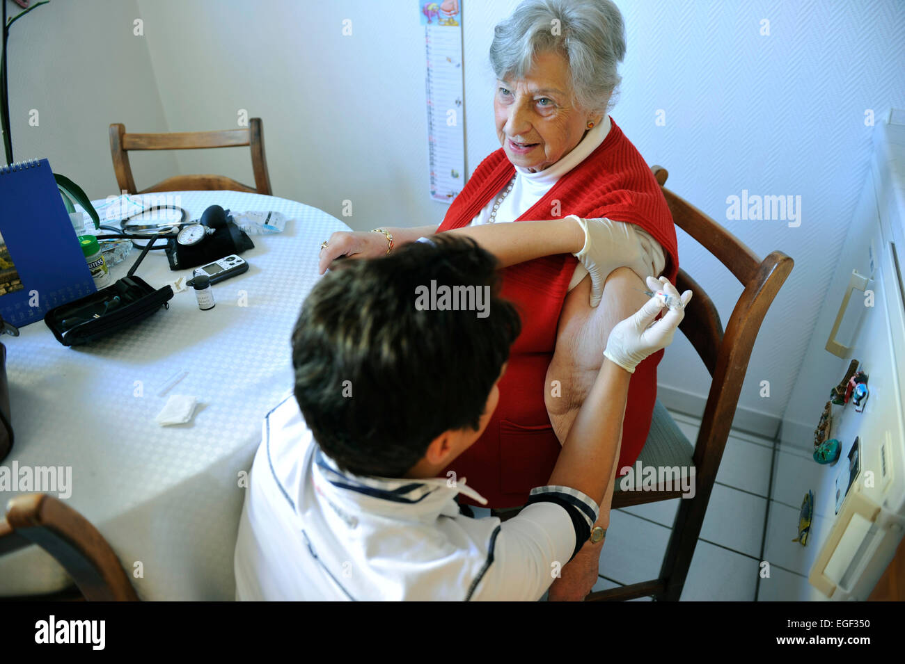 The elderly and sick visit to the doctor's assistant relieves the practice owner of routine tasks such as taking Stock Photo