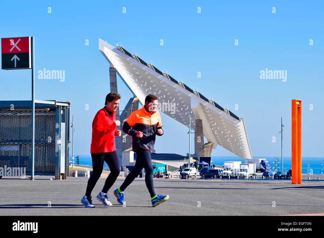 Two runners at Forum. Photovoltaic pergola, Forum,  Diagonal Mar area, Barcelona. Catalonia, Spain. - Stock Image