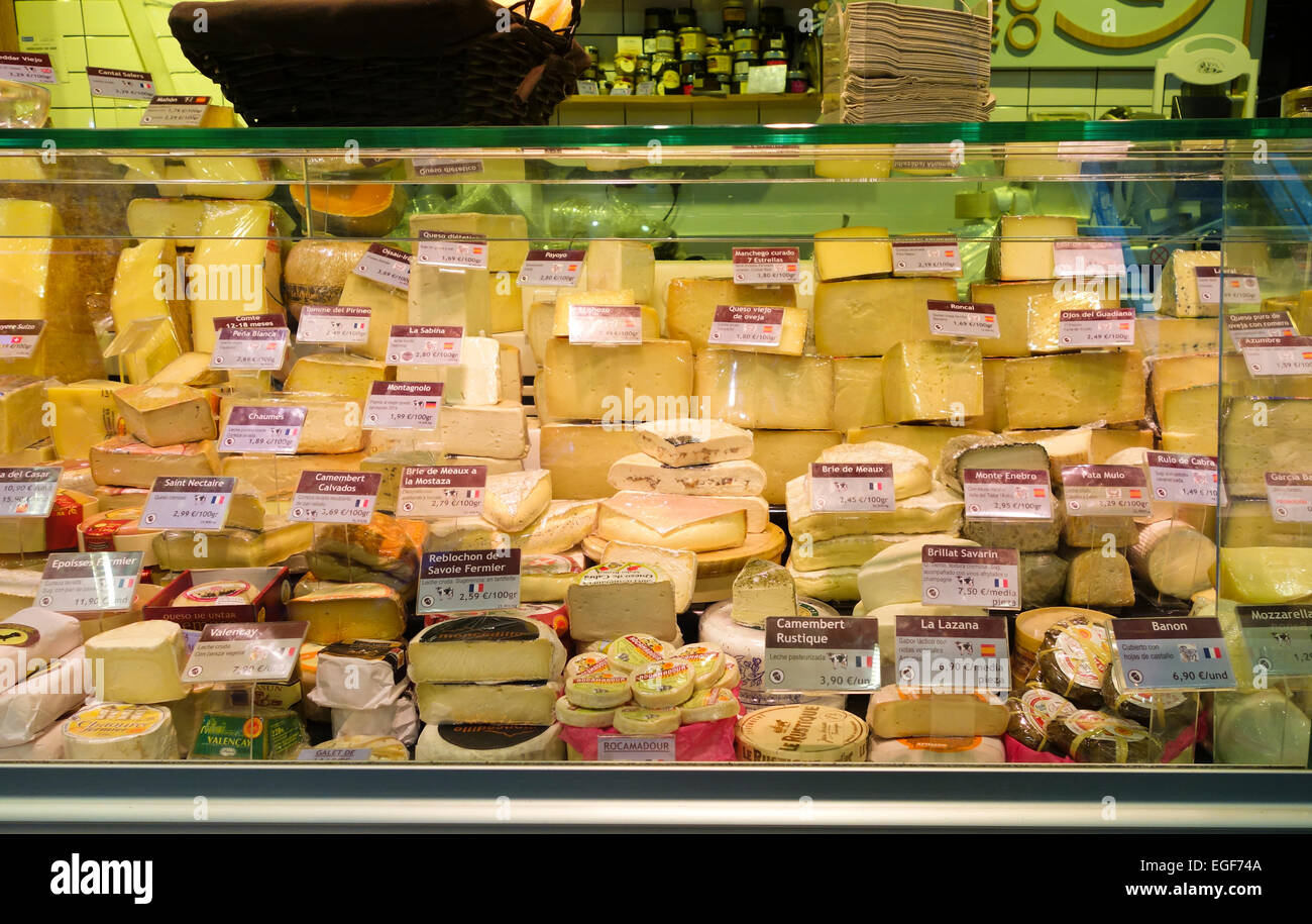 Different cheeses on display at cheese store, San Anton covered Market, Madrid, Spain. Stock Photo