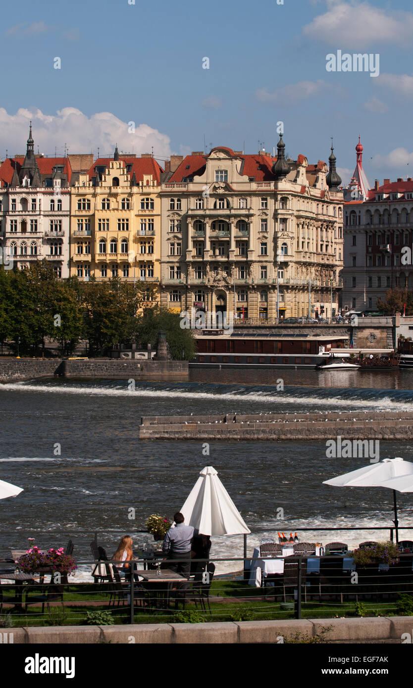 Al fresco dining beside the Vltava River in central Prague. - Stock Image