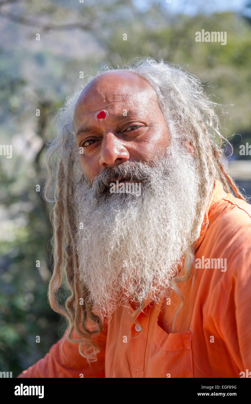 A Sadhu or Holy Man sat above the Ganges in the Himalayan foothills of Rishikesh, Uttarkahand, India - Stock Image