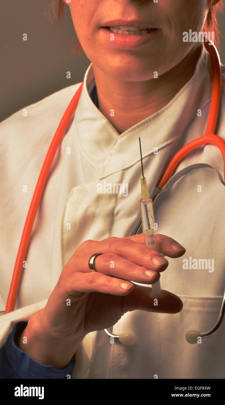 Symbol photo: syringe, injection. - Stock Image