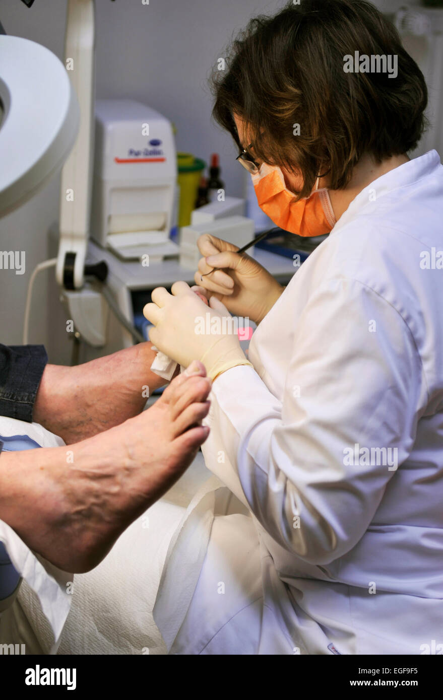 A podiatrists' work in his surgery is more than just foot care. The specialist for footwear, walking and running - Stock Image
