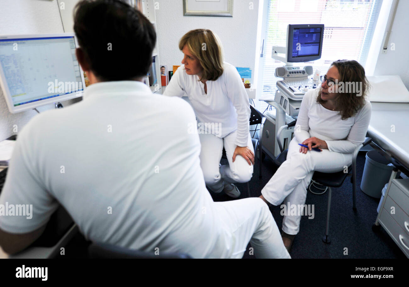 The joint general practice in a suburb of a large city is well arranged with its four doctors. The general practitioners - Stock Image