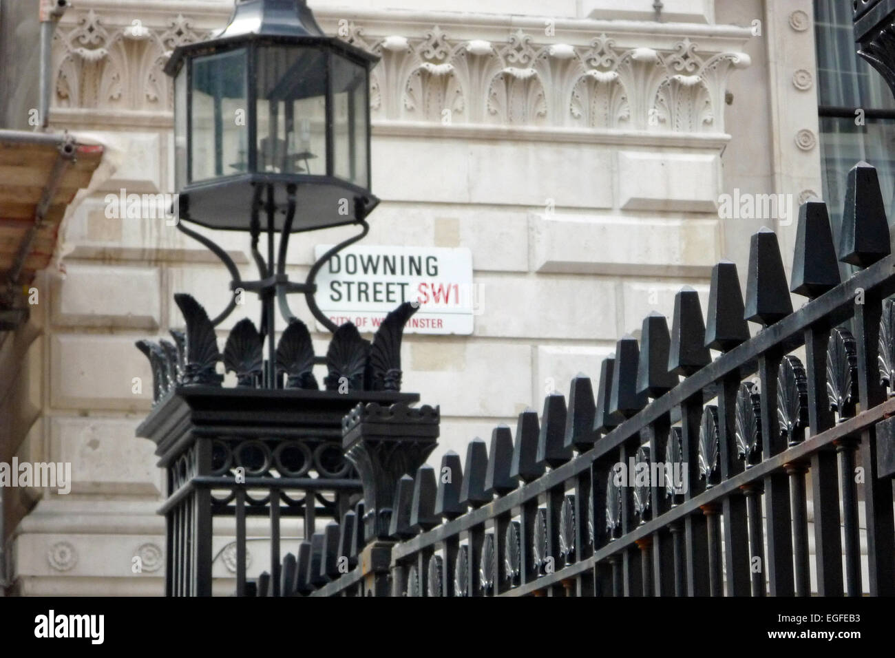 Street sign and railings outside Downing Street, London, UK, the home of the British Prime Minister - Stock Image