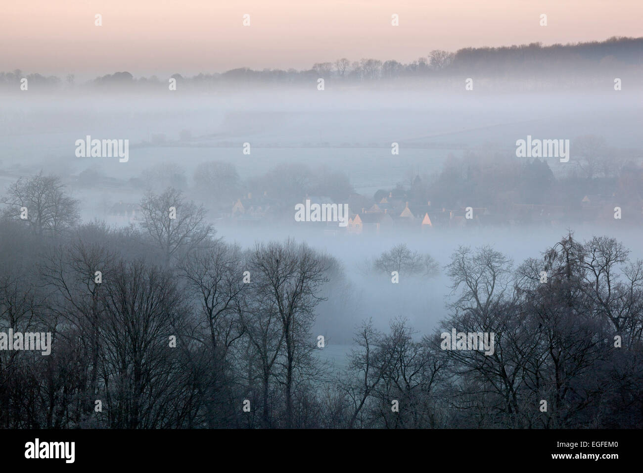 Winter view of Lower Swell village in dawn frost and fog, Stow-on-the-Wold, Cotswolds, Gloucestershire, England, - Stock Image