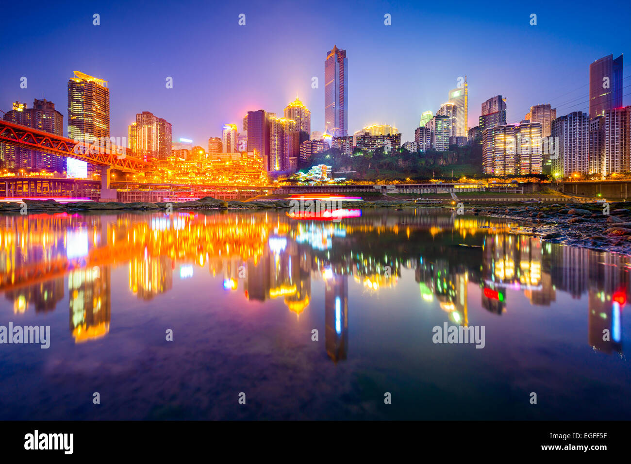 Chongqing, China riverside cityscape at night on the Jialing River. - Stock Image