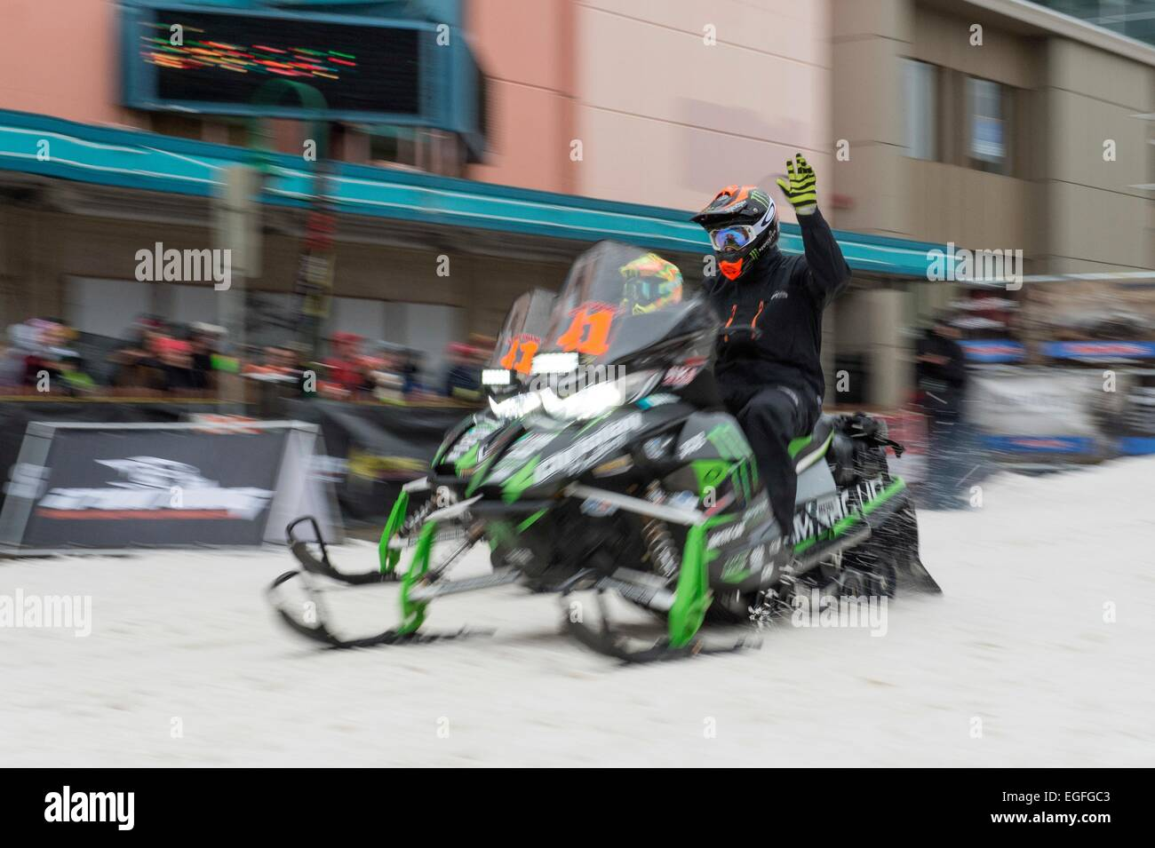 Competitors take off at the start the 2,000 mile Iron Dog race February 21, 2015 in Anchorage, Alaska. The Iron - Stock Image