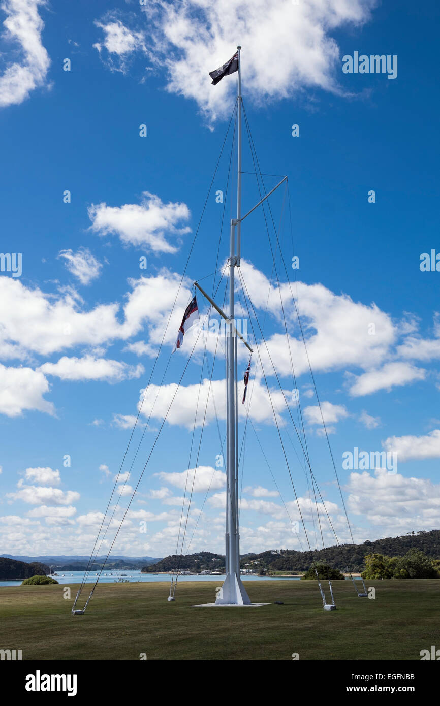 The flagstaff at Waitangi treaty grounds flying the 3 official New Zealand flags. Stock Photo