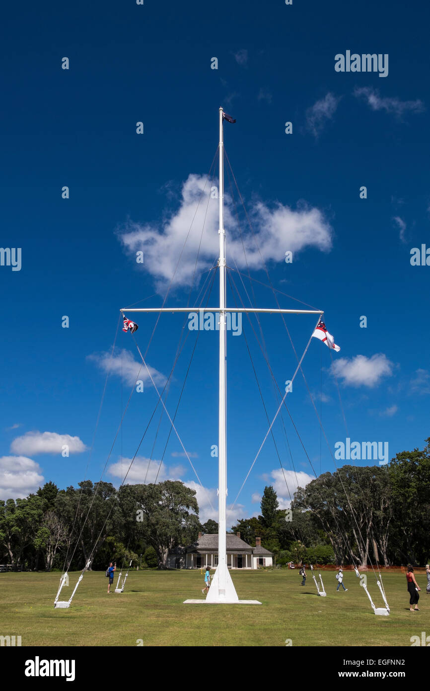 The flagstaff at Waitangi treaty grounds flying the 3 official New Zealand flags. - Stock Image