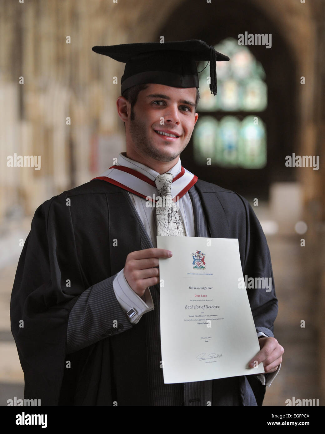 Graduate Student with certificate - Stock Image