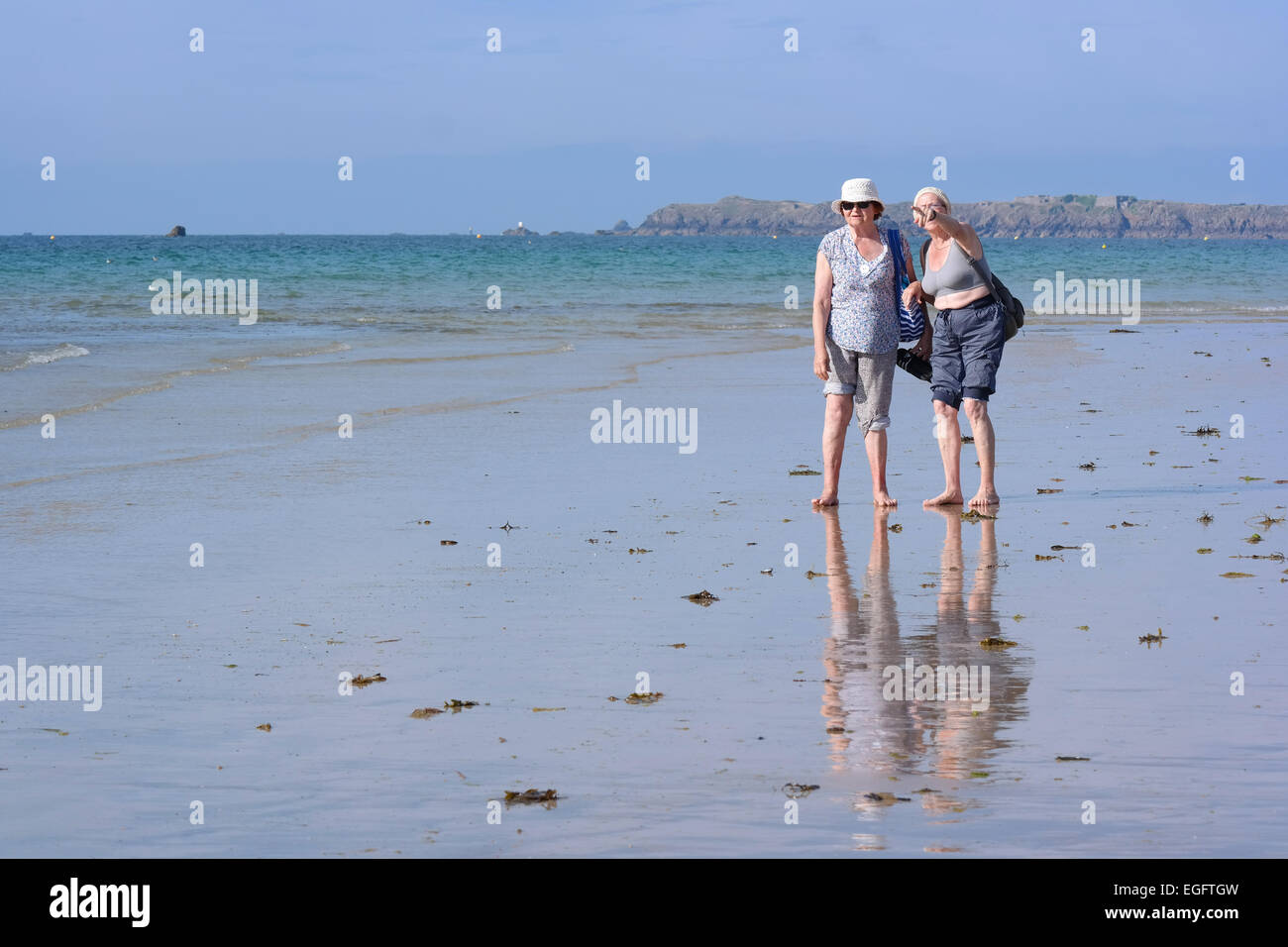 FRANCE - JULY 2014  Senior beach walking ladies at seashore in Saint-Malo, Brittany, France - Stock Image