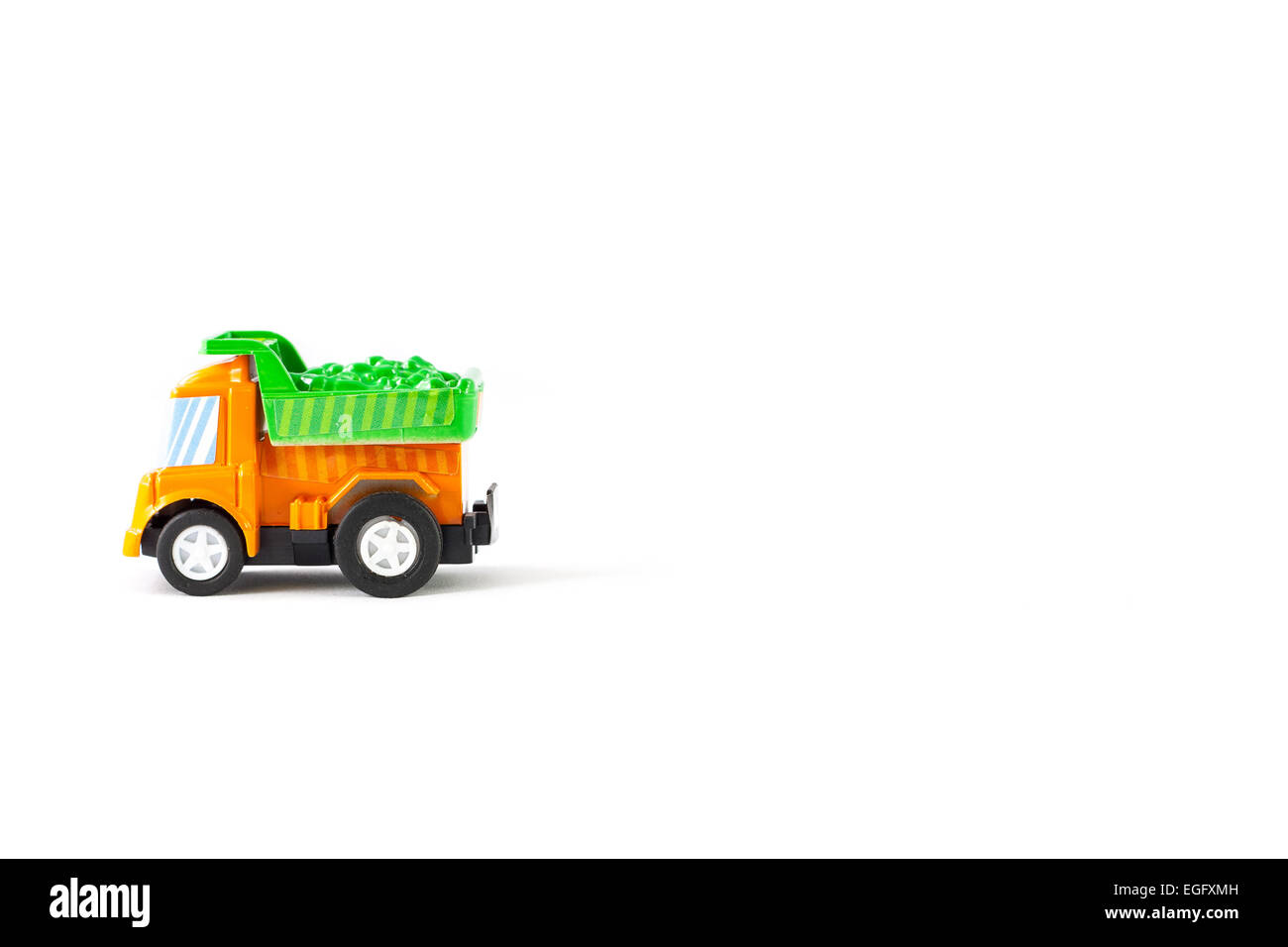 Earth moving toy. Orange and Green truck. - Stock Image