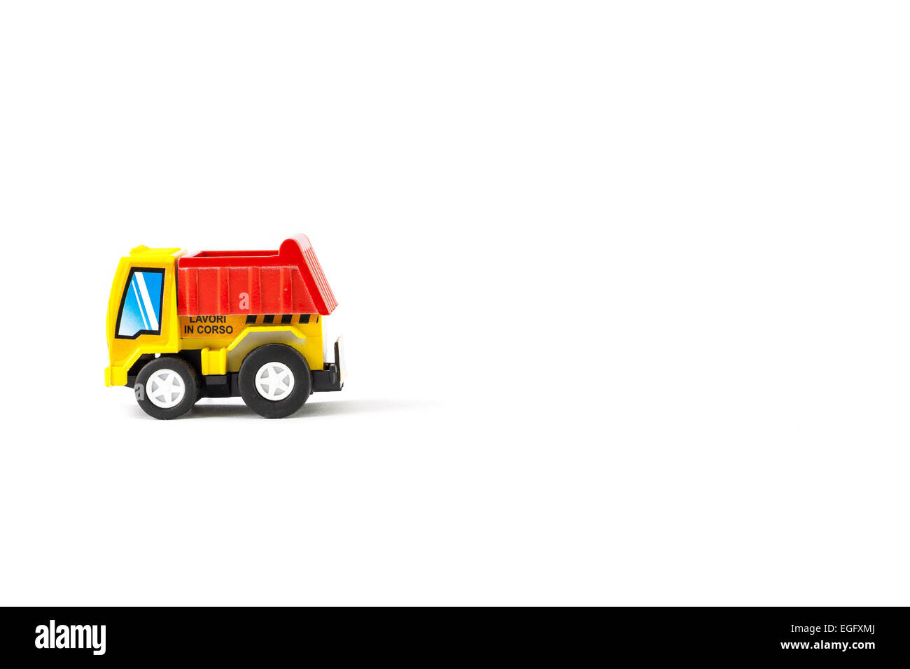 Earth moving toy. Yellow and red truck. - Stock Image