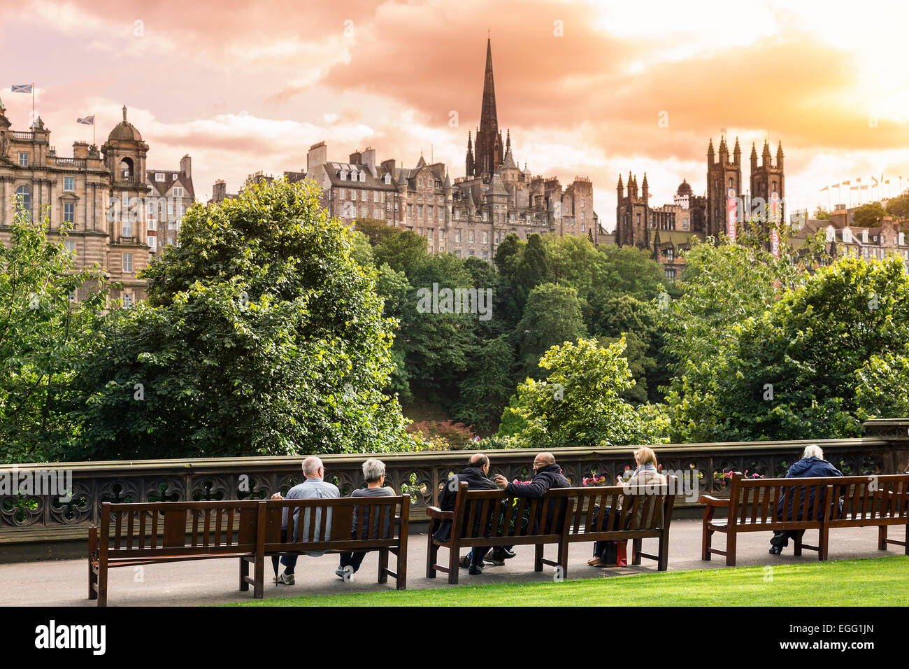 Group of people relaxing in a garden, Princes Street Gardens, Edinburgh, Scotland - Stock Image