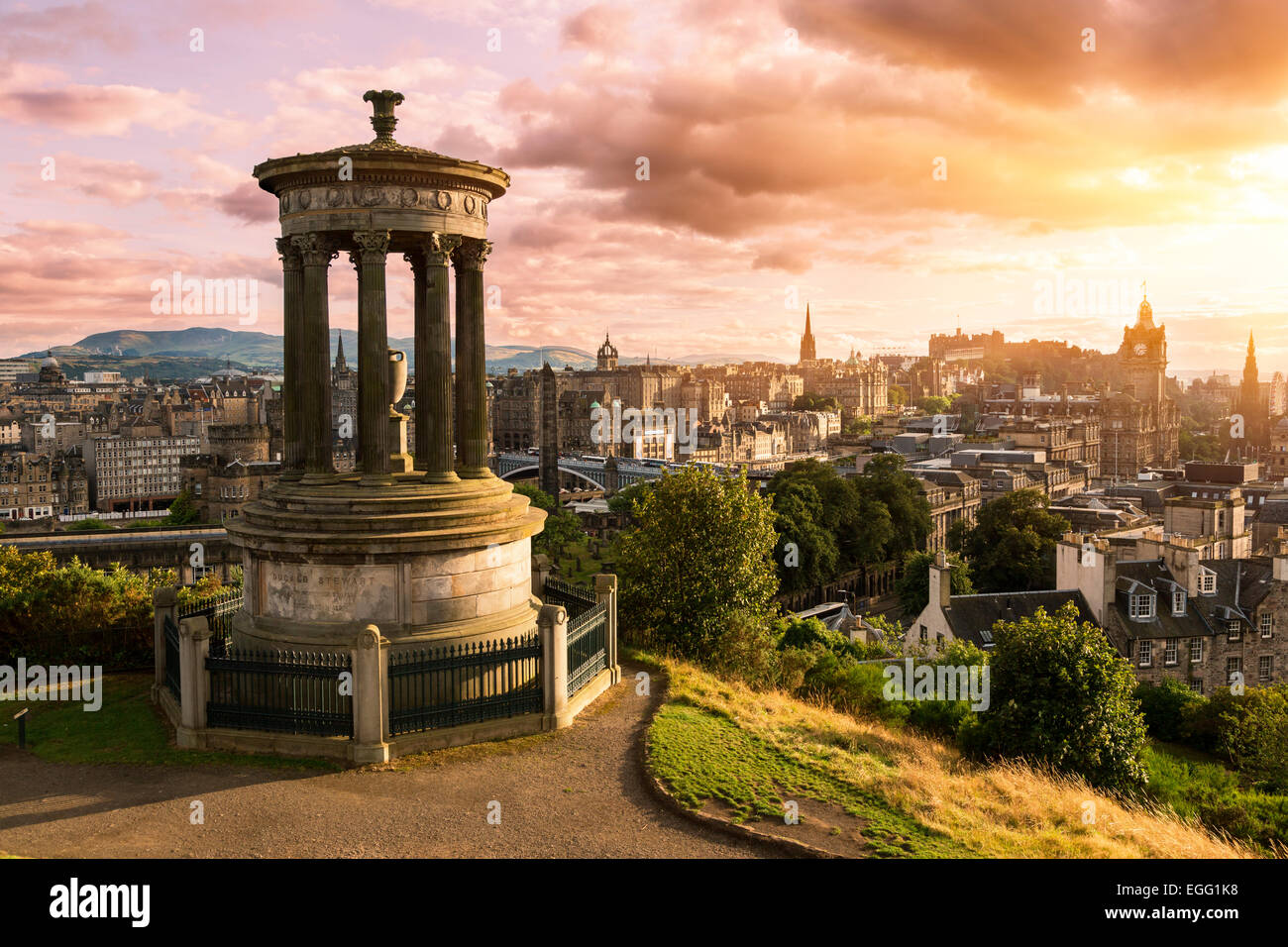 Edinburgh skyline from Calton Hill at sunset - Stock Image