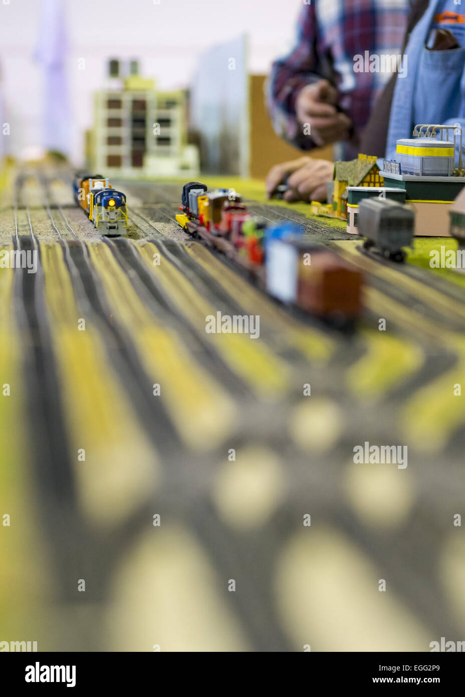 Hicksville, New York, USA. 22nd Feb, 2015. Members of a model train club adjust Freight Office and tracks layout - Stock Image