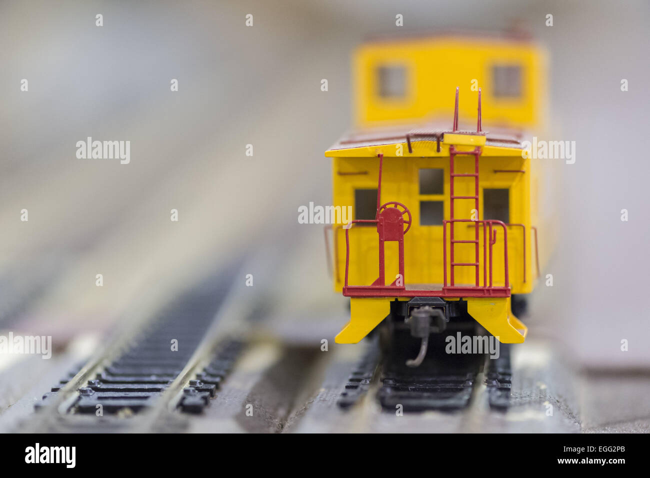 Hicksville, New York, USA. 22nd Feb, 2015. A Union Pacific yellow caboose model train car travels on the track at - Stock Image