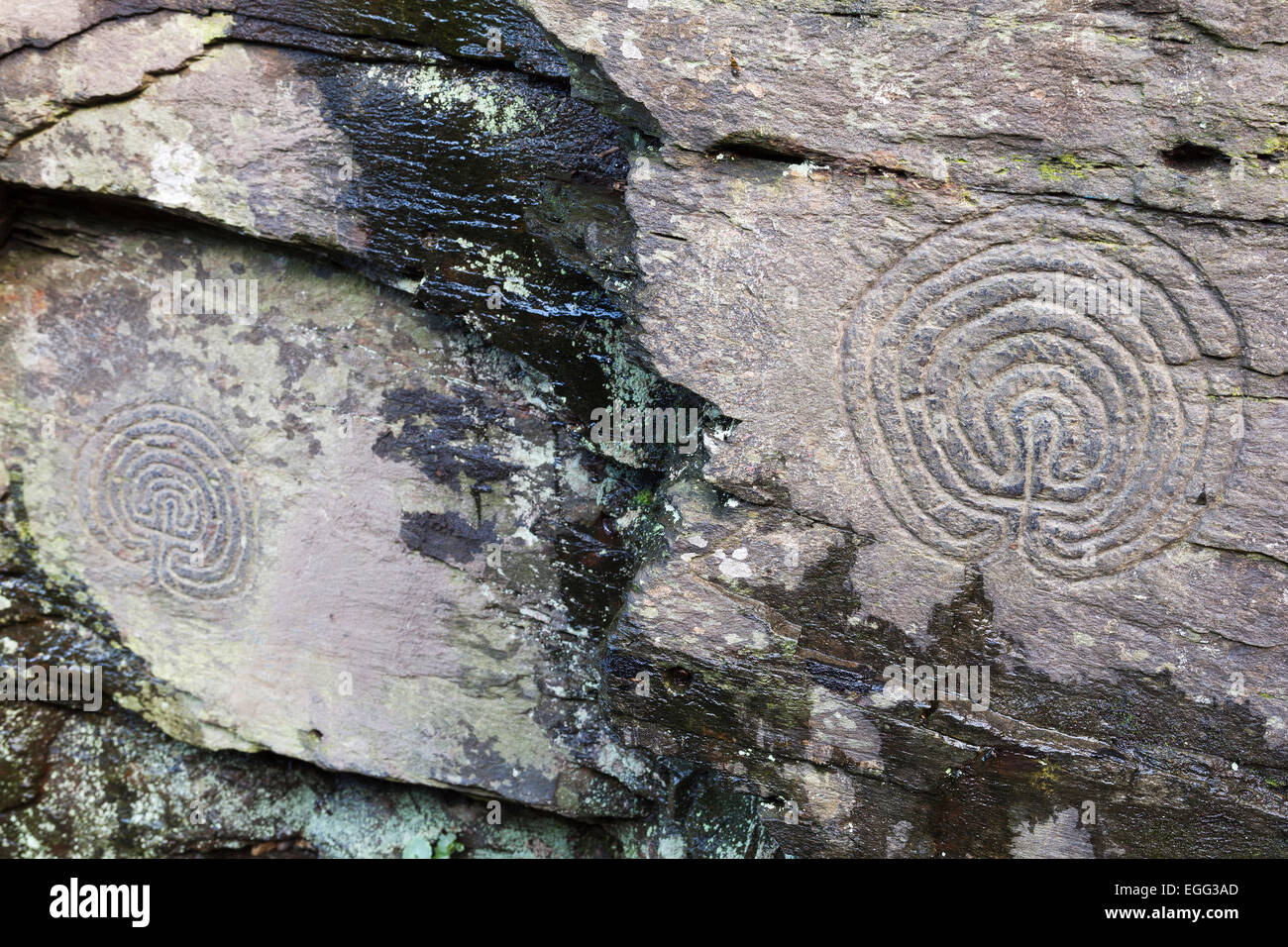 'Rocky Valley' rock carvings, labyrinth petroglyphs, Cornwall, England, UK - Stock Image