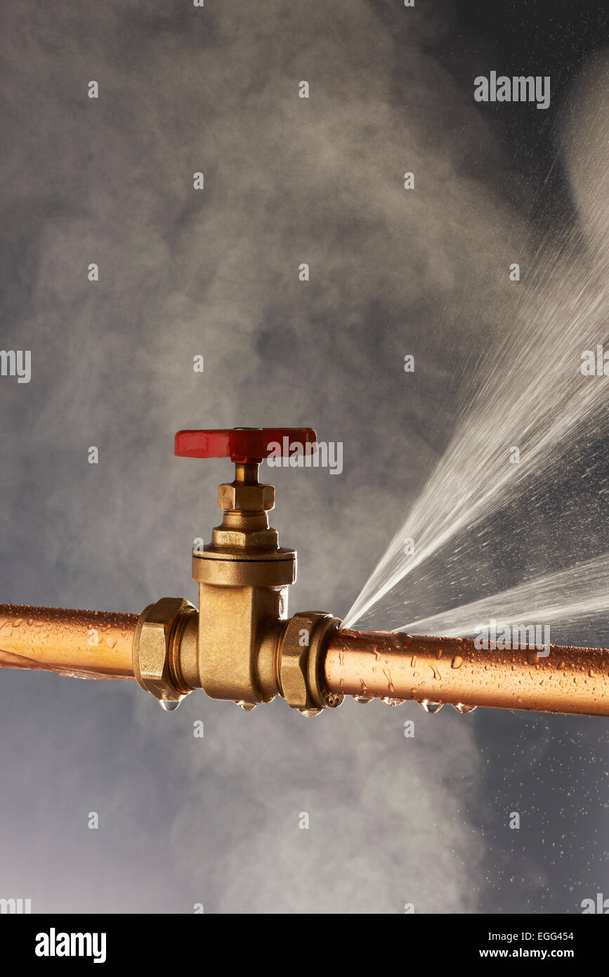 Plumbing burst Leaking Pipe with Tap - Stock Image