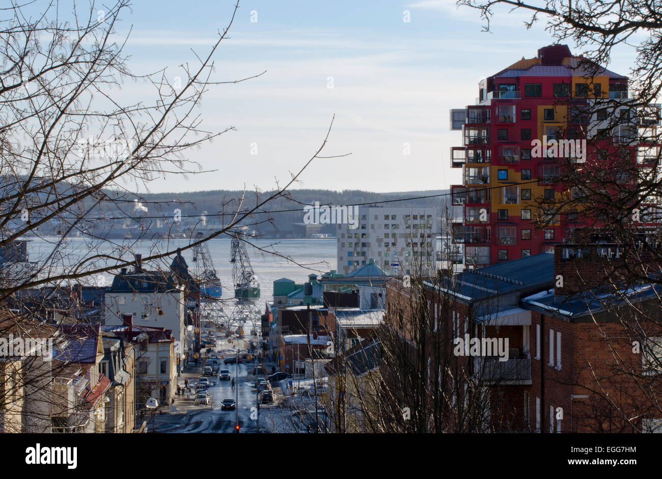 View from upper part off town along main business street with harbor in background. - Stock Image