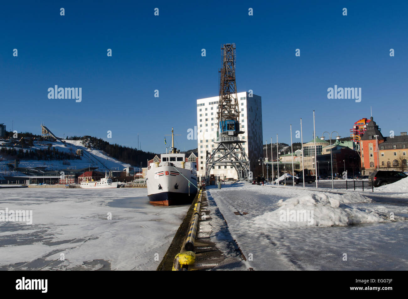 View from ornskodsvik harbor with ski jumping facility in background. - Stock Image