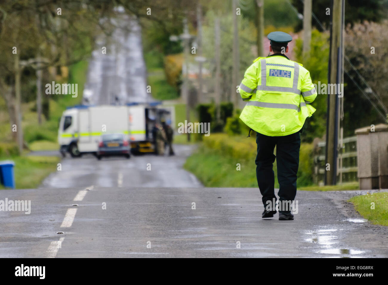 Crumlin, County Antrim - Army ATOs were called to deal with a suspicious device found on the Largy Road outside - Stock Image