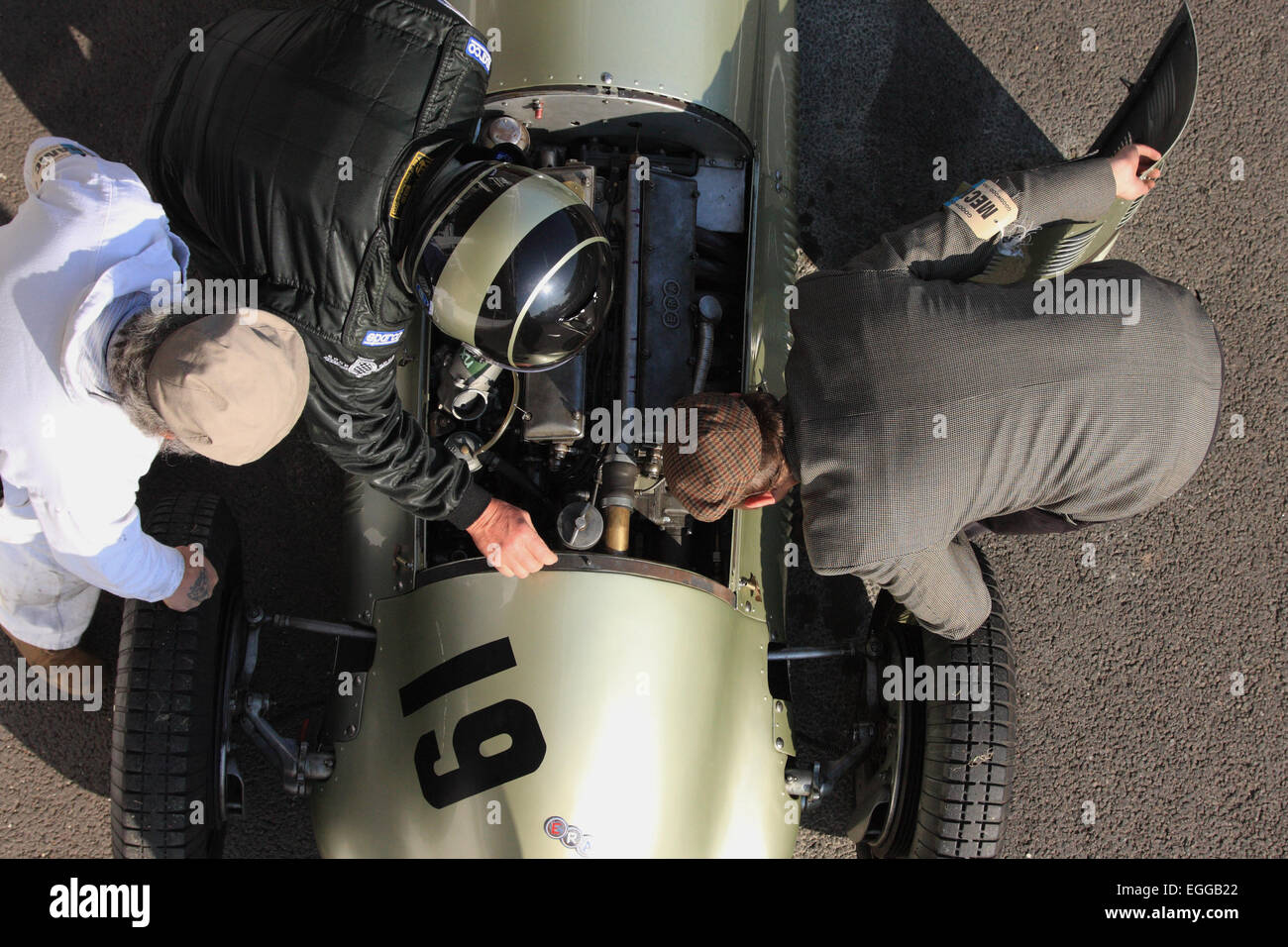 Overhead view of Thomas Steinke's 1949 Maserati 4CLT receiving attention in the pit lane / Goodwood Revival - Stock Image
