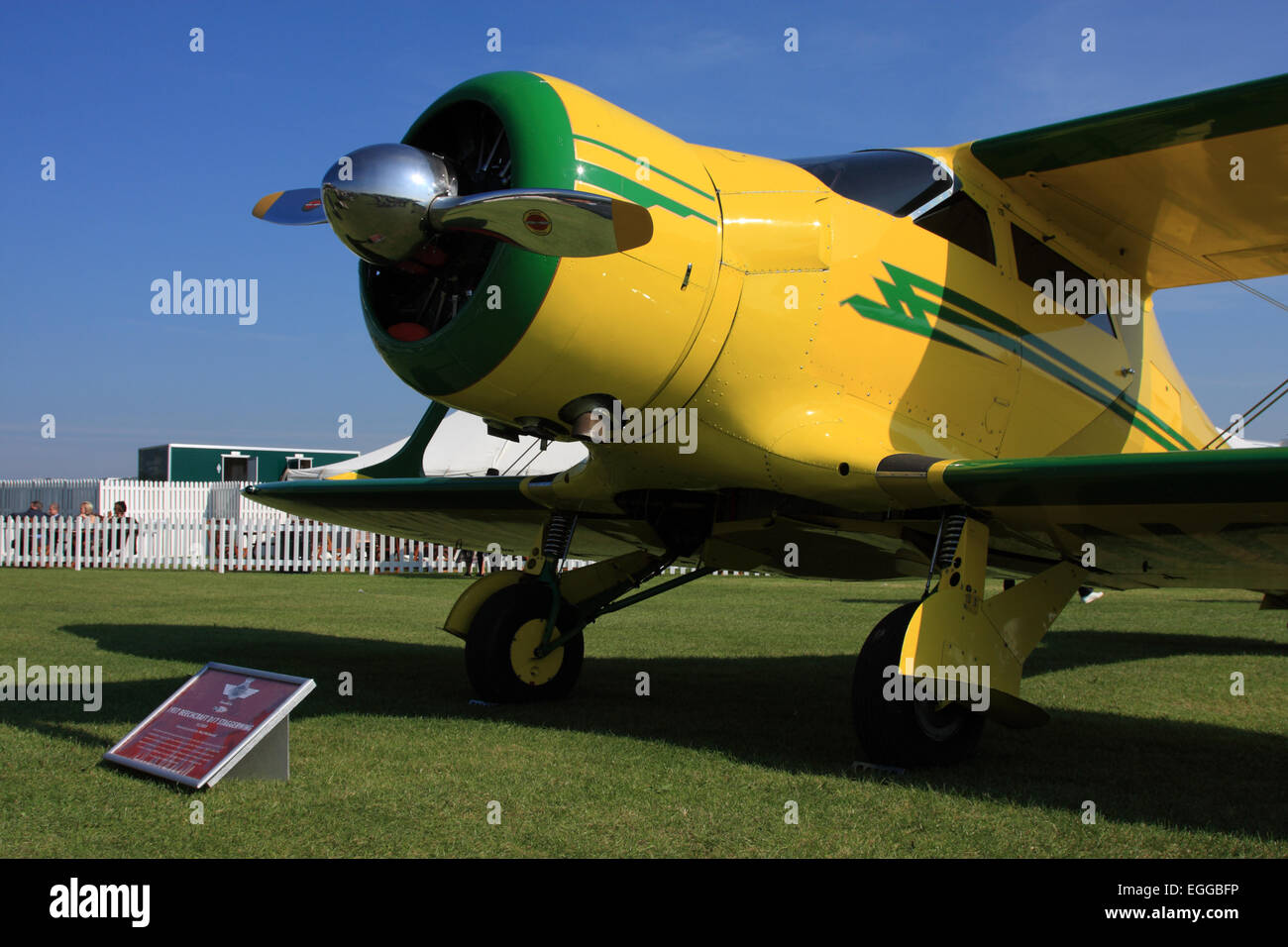 1937 Beechcraft D17 Staggerwing against a cloudless sky / Goodwood Revival / Goodwood / UK - Stock Image