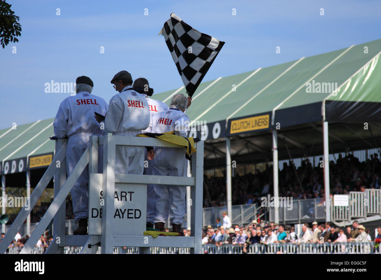 A welcome sight - the chequered flag is waved at the end of a race / Goodwood Revival / Goodwood / UK - Stock Image