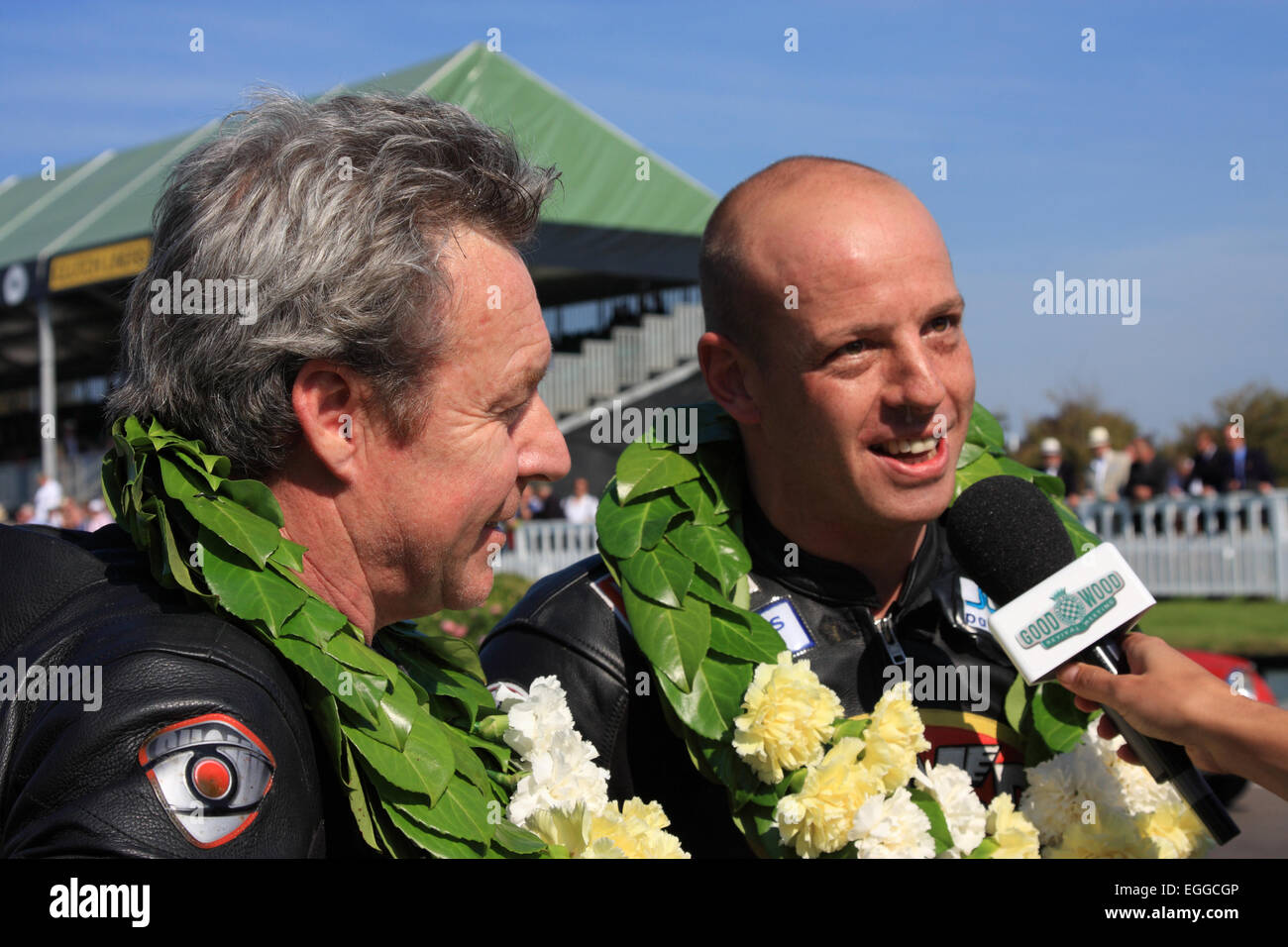Former 500cc World Champion Wayne Gardner (left) & Mark Sharrock after winning the Barry Sheene Memorial / Goodwood - Stock Image